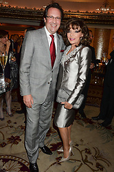 JOAN COLLINS and PERCY GIBSON at the inaugural Stephen Lawrence Memorial Ball held at The Dorchester, Park Lane, London on 17th October 2013.