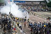 Police fire tear gas as protesters occupy roads in front of the Central Government Offices, during a protest against a proposed extradition law in Hong Kong, SAR China, on Wednesday, June 12, 2019. Hong Kong's legislative chief postponed the debate on legislation that would allow extraditions to China after thousands of protesters converged outside the chamber demanding the government to withdraw the bill. Photo by Suzanne Lee/PANOS