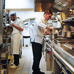 Chef Xavier Caussade cooking a dish with truffle in the kitchen at Maison de la Truffe. Paris, France. Nov. 29, 2018. <br /> Le Chef Xavier Caussade prepare un plat avec de la truffe dans les cuisines de la Maison de la Truffe. Paris, France. 29 novembre 2018.