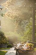 Formal garden of local hotel restaurant on sunny day, Corte, Corsica, France