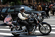 Member of the Patriot Guard Riders arriving to the Bedsford Central Presbyterian church on his bike, to honour LCpl. Nicholas J. Whyte, whose funeral is to be held today in Brooklyn, New York, NY., on Friday, June 30, 2006. LCpl. Nicholas J. Whyte, a 21-year-old American serviceman died  on June 21, 2006, while conducting combat operations in Al Anbar province, Iraq. The Patriot Guard Riders is a diverse amalgamation of riders from across the United States of America. Besides a passion for motorcycling, they all have in common an unwavering respect for those who risk their lives for the country's freedom and security. They are an American patriotic group, mainly but not only, composed by veterans from all over the United States. They work in unison, calling upon tens of different motorcycle groups, connected by an internet-based web where each of them can find out where and when a 'Mission' is called upon, and have the chance to take part. This way, the Patriot Guard Riders can cover the whole of the United States without having to ride from town to town but, by organising into different State Groups, each with its own State Captain, they are still able to maintain strictly firm guidelines, and to honour the same basic principles that moves the group from the its inception. The main aim of the Patriot Guard Riders is to attend the funeral services of fallen American servicemen, defined as 'Heroes' by the group,  as invited guests of the family. These so-called 'Missions' they undertake have two basic objectives in particular: to show their sincere respect for the US 'Fallen Heroes', their families, and their communities, and to shield the mourners from interruptions created by any group of protestors. Additionally the Patriot Guard Riders provide support to the veteran community and their families, in collaboration with the other veteran service organizations already working in the field.   **ITALY OUT**
