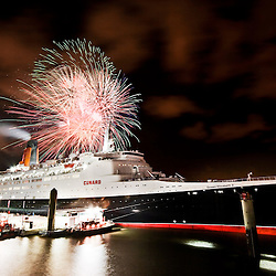 Fireworks explode over the Mersey as the QE2 leaves Liverpool for the last time.
