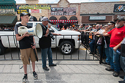Bob Davis gets the crowd ready for his official Main Street photo during the 75th Annual Sturgis Black Hills Motorcycle Rally.  SD, USA.  August 4, 2015.  Photography ©2015 Michael Lichter.