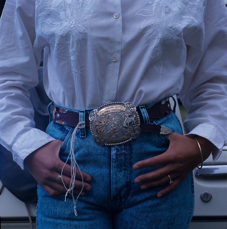 Australia, Victoria, Cockatoo, (MR) Detail of rodeo cowgirl Karen McLoughlin's belt buckle and tight jeans at American style rodeo