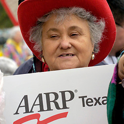 Austin, TEXAS 08 FEB 2005: A hispanic senior displays a poster from the American Association of Retired Persons (AARP) at a rally for citizen's issues at the Texas Capitol. 2005 ©Bob Daemmrich