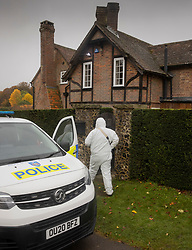 CAPTION UPDATE © Licensed to London News Pictures. 24/10/2020. Christmas Common, UK. A police forensics investigator enters a house at Christmas Common where it is reported that a man entered the property and was found naked by the home owner - after the body of a woman was found on Friday 23rd October at nearby Watlington Hill. An injured man was arrested by police nearby after a man was seen acting suspiciously in a pub. Photo credit: Peter Macdiarmid/LNP