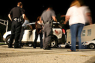 Clifton Heights, Pennsylvania - Police arrest a women at a DUI checkpoint for suspicion of driving under the influence.