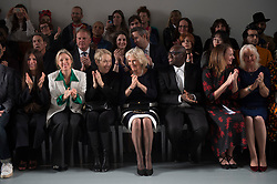 The Duchess of Cornwall (centre) sits on the front row during a visit to London Fashion Week at the BFC Show Space, London.