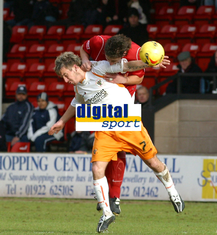 Photo: Dave Linney.<br />Walsall v Blackpool. Coca Cola League 1. 31/12/2005.<br />Keigan Parker(Blackpool) is beaten to the ball by  Ian Roper(Walsall)