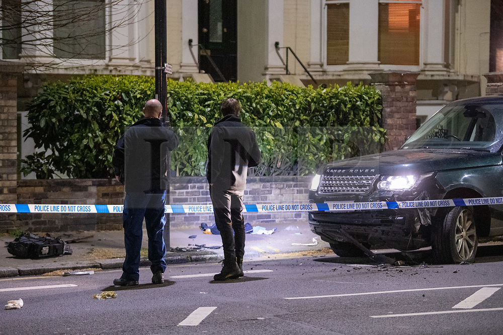 © Licensed to London News Pictures. 08/04/2021. London, UK. Forensic investigators survey the scene on Chiswick High Road following a incident in which a vehicle was stopped by armed police at approximately 22:30hrs on Wednesday 07/04/2021 when police approached the vehicle, officers discovered the lone male occupant had sustained a number of serious self-inflicted injuries. First aid was commenced immediately and the London Ambulance Service were called. The male has been taken to a west London hospital. Photo credit: Peter Manning/LNP