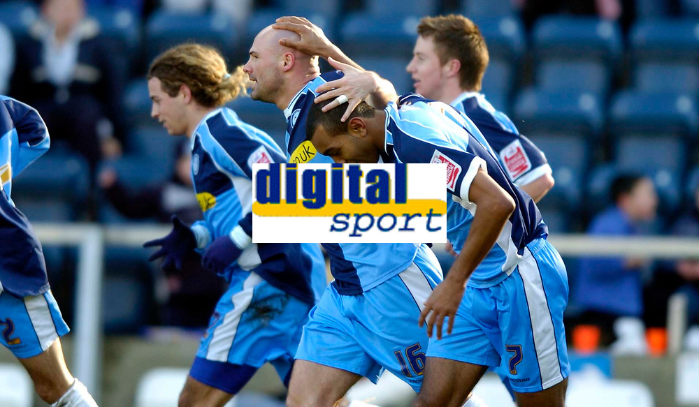 Photo: Richard Lane.<br />Wycombe Wanderers v Oxford United. Coca Cola League 2. 25/02/2006. <br />Wycombe's Kevin Betsy (R) celebrates his goal with Tommy Mooney.