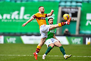 Allan Campbell (#6) of Motherwell FC clears the ball ahead of Lewis Stevenson (#16) of Hibernian FC during the SPFL Premiership match between Hibernian FC and Motherwell FC at Easter Road, Edinburgh, Scotland on 27 February 2021.