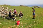 Tourists at Acinipo Roman archaeological site, Ronda la Vieja, Cadiz province, Spain