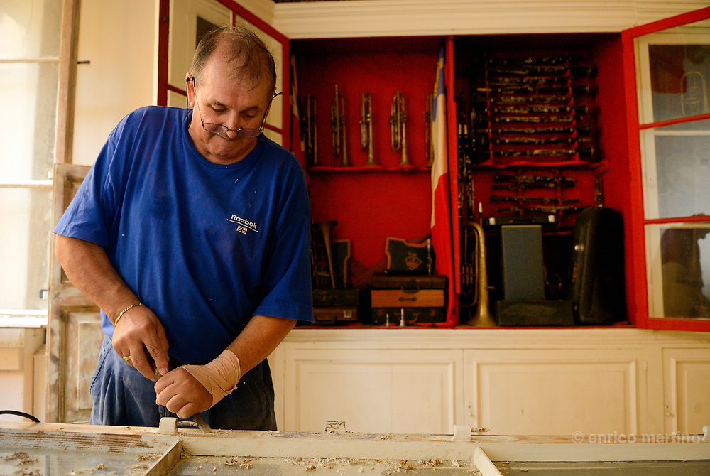The Saint Lawrence Band Club, a volunteering member working in the small museum of the Band memorabilia. Founded in 1883 is a non-profit organisation with the main scope of teaching music and of being the social hub of Vittoriosa. The band in 1891 also obtained the patronage of the duke of Edinburgh which consequently became the band's name. In the last years tha band changed his name in Saint Lawrence Band Club.