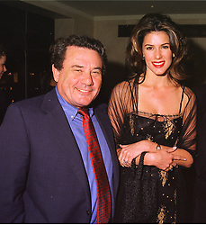 MR SOL KERZNER the South African multi millionaire and his fiancee MISS CHRISTINA ESTRADA at a dinner in London on 30th September 1998.<br /> MKK 76 2olo