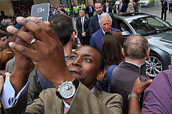 June 26, 2017 - Manchester, United Kingdom - A man tries to snap a selfie of himself with PRINCE CHARLES at Manchester Town Hall. The Prince of Wales and Duchess of Cornwall attended a roundtable discussion with community leaders and young people about the impact of the recent terror attack on their communities and how Manchester united in the immediate aftermath. (Credit Image: © Anthony Devlin/i-Images via ZUMA Press)
