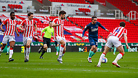 Derby County's Patrick Roberts brings the ball forward under pressure from Stoke City's Tommy Smith, John Obi Mikel James Chester and Joe Allen<br /> <br /> Photographer Lee Parker/CameraSport<br /> <br /> The EFL Sky Bet Championship - Stoke City v Derby County - Saturday 20th March 2021 - bet365 Stadium - Stoke-on-Trent<br /> <br /> World Copyright © 2021 CameraSport. All rights reserved. 43 Linden Ave. Countesthorpe. Leicester. England. LE8 5PG - Tel: +44 (0) 116 277 4147 - admin@camerasport.com - www.camerasport.com
