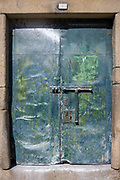 Unusual green pained doorway with lock and bolt in V|la Nova de Gaia in Porto, Portugal