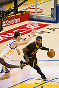 Cleveland Cavaliers guard Kyrie Irving (2) drives on Golden State Warriors guard Klay Thompson (11) during Game 5 of the NBA Finals at Oracle Arena in Oakland, Calif., on June 12, 2017. (Stan Olszewski/Special to S.F. Examiner)