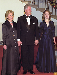 The First Family descends the Grand Staircase to meet their guests at the White House Millennium dinner in Washington, D.C. on December 31, 1999. (L-R) First Lady Hillary Rodham Clinton, United States President Bill Clinton, Chelsea Clinton. Photo by Ron Sachs/CNP/ABACAPRESS.COM