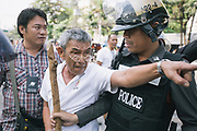 A prospective voter argues with police after being prevented from accessing the ballots by anti-government protesters on election day in Bangkok.