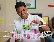 Senior Osmar Barrera works on the load tolerance of a straw bridge during in a summer intern program with FH-HP at Washington High School, June 16, 2014.