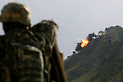 Embedded with the US Army, 3rd brigade combat team, 10th Mountain division in the highly volatile Logar province of Afghanistan in early May 2009...Photo: Guilad Kahn. ..Soldiers look as a 2,000 pound bomb is dropped into a cave used by the taleban to scout and stage attacks..