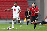 TIRANA, ALBANIA - MARCH 28: Raheem Sterling of England is chased by Adrian Ismajli of Albania during the FIFA World Cup 2022 Qatar qualifying match between Albania and England at the Qemal Stafa Stadium on March 28, 2021 in Tirana, Albania. Sporting stadiums around Europe remain under strict restrictions due to the Coronavirus Pandemic as Government social distancing laws prohibit fans inside venues resulting in games being played behind closed doors (Photo by MB Media)
