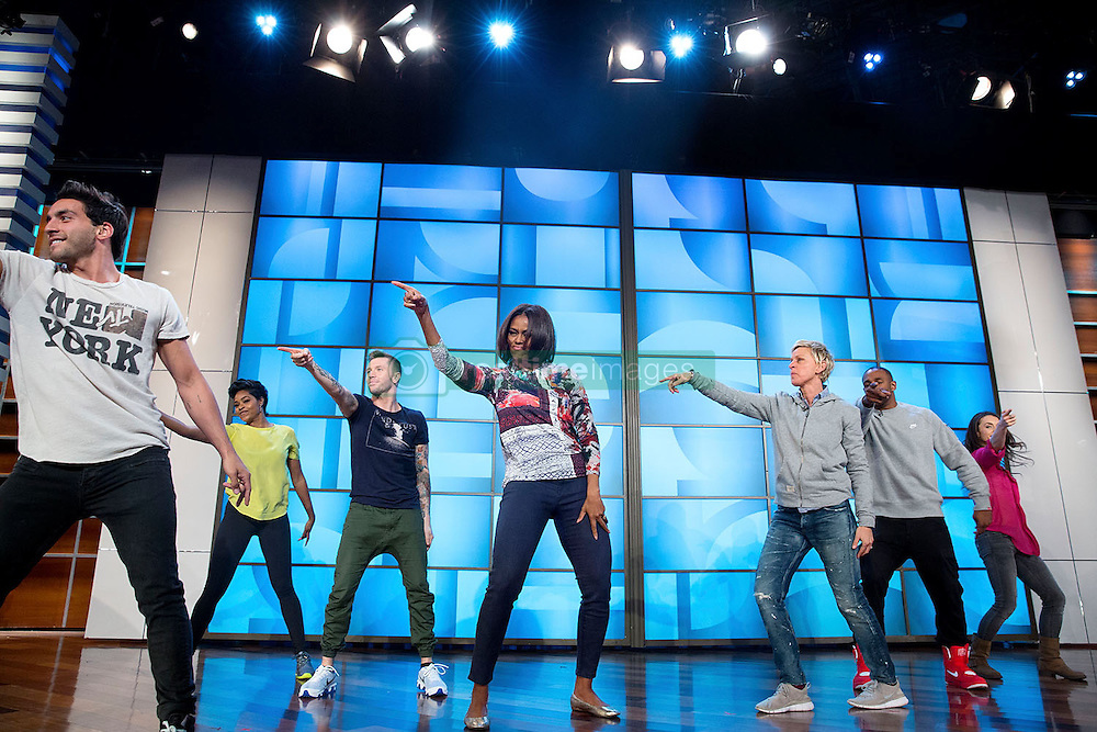 """First Lady Michelle Obama rehearses with Ellen DeGeneres and the """"So You Think You Can Dance"""" dancers for a #GimmeFive """"Let's Move!"""" dance, prior to a taping of The Ellen DeGeneres Show in Burbank, Calif., March 12, 2015. (Official White House Photo by Amanda Lucidon)<br /> <br /> This official White House photograph is being made available only for publication by news organizations and/or for personal use printing by the subject(s) of the photograph. The photograph may not be manipulated in any way and may not be used in commercial or political materials, advertisements, emails, products, promotions that in any way suggests approval or endorsement of the President, the First Family, or the White House."""