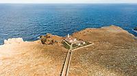 Aerial view of Punta Nati lighthouse at arid terrain, Balears Island, Spain.