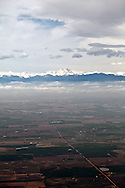 Aerial view of the Rocky Mountains and their foothills near Denver, Colorado, and of farmland in the adjacent plains. WATERMARKS WILL NOT APPEAR ON PRINTS OR LICENSED IMAGES.