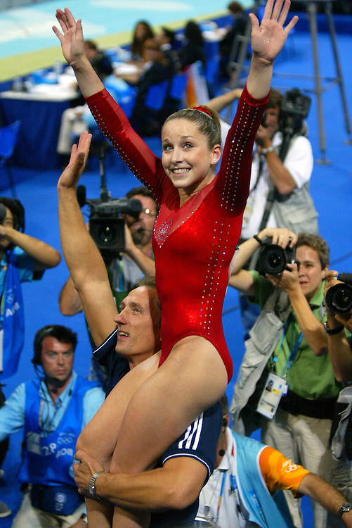 United State gymnast Carly Patterson was held aloft by her coach Evgeny Marchenko after the results of her floor exercise clinched the gold medal for Patterson in the 2004 Summer Olympic Games at the Olympic Indoor Hall in Athens, Greece.