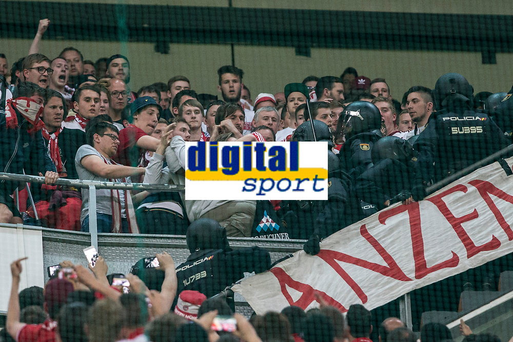 Supporters of FC Bayern Munchen and Spanish police created disturbs during the match of Champions League between Real Madrid and FC Bayern Munchen at Santiago Bernabeu Stadium  in Madrid, Spain. April 18, 2017. (ALTERPHOTOS)
