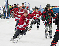 The Pylons and Broots Magoots (Shinny -35 division) hit the ice Friday for the first day of tournament action at the New England Pond Hockey Classic on Meredith Bay.  (Karen Bobotas/for the Laconia Daily Sun)