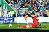 York City's William Boyle slides in to tackle Plymouth Argyle's Reuben Reid during the Sky Bet League 2 match between Plymouth Argyle and York City at Home Park, Plymouth, England on 28 March 2016. Photo by Graham Hunt.