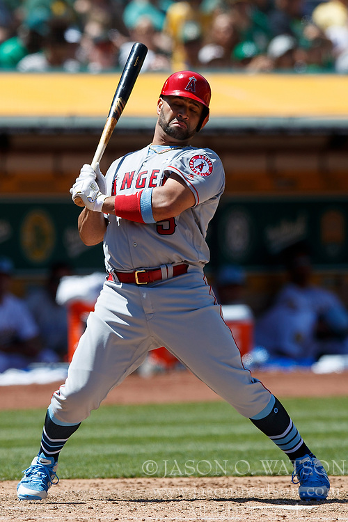 OAKLAND, CA - JUNE 17: Albert Pujols #5 of the Los Angeles Angels of Anaheim avoids an inside pitch during the seventh inning against the Oakland Athletics at the Oakland Coliseum on June 17, 2018 in Oakland, California. The Oakland Athletics defeated the Los Angeles Angels of Anaheim 6-5 in 11 innings. (Photo by Jason O. Watson/Getty Images) *** Local Caption *** Albert Pujols