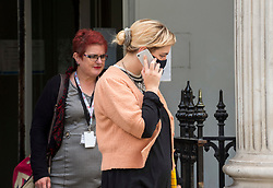 """© Licensed to London News Pictures; FILE PICTURE 22/06/2021; Bristol, UK. JASMINE YORK (in orange top) outside Bristol Crown Court. Jasmine York is charged with riot and arson and is one of the defendants facing charges related to a """"Kill the Bill"""" protest and riot against the Police, Crime, Sentencing and Courts Bill. During the protest on 21 March 2021 two police vehicles were burnt out and windows on Bridewell Police Station were smashed. The Police, Crime, Sentencing and Courts Bill proposes new restrictions on protests. Photo credit: LNP."""