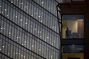 Two businessmen hold a meeting in a financial office building and the windows of the Walkie Talkie building in the heart of the Square Mile, the capital's historical and financial centre, on 1st November 2017, in the City of London, England.