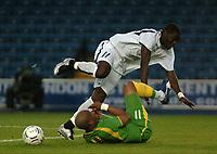 Photo: Tony Oudot.<br /> Ghana v Senegal. International Friendly. 21/08/2007.<br /> Sulley Mantari of Ghana goes over Hadji El Diouf of Senegal