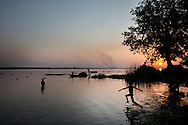 A boy dives into the Nile after a hot day in Melut near the border of North and South Sudan and Southern Sudan's most productive oil area.