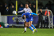 AFC Wimbledon defender Terell Thomas (6) heading the ball during the EFL Sky Bet League 1 match between AFC Wimbledon and Peterborough United at the Cherry Red Records Stadium, Kingston, England on 12 March 2019.