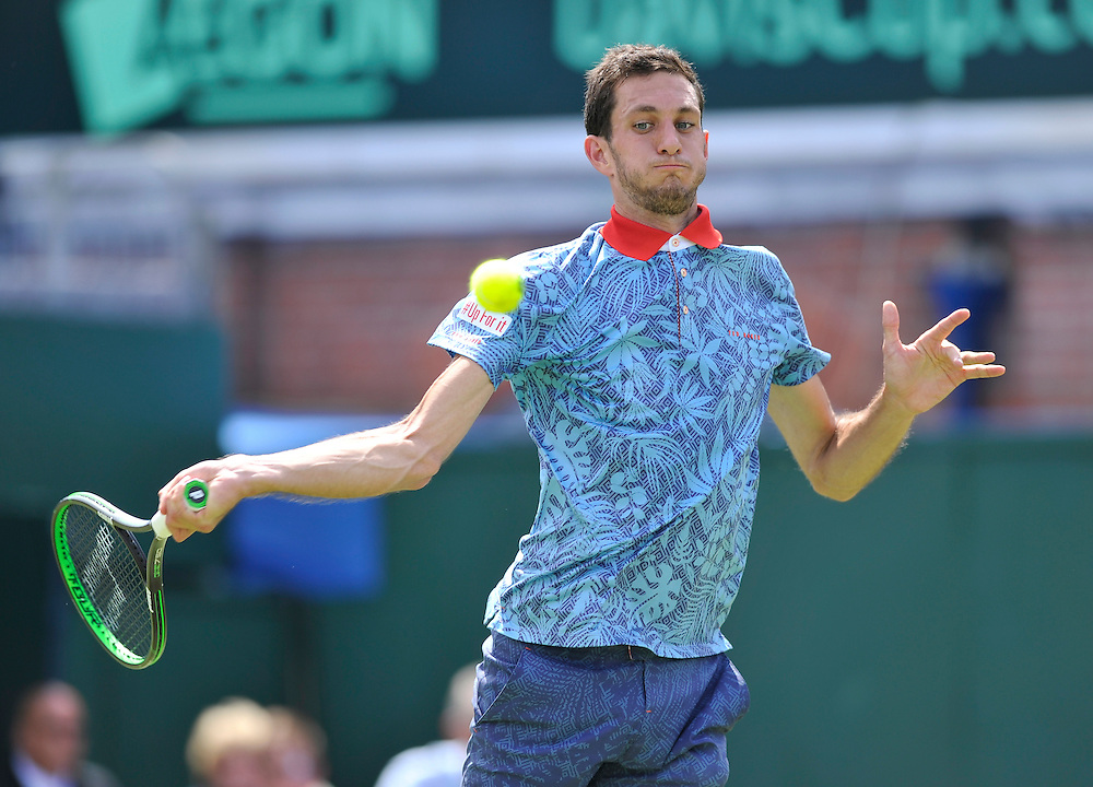 James Ward in action during his defeat to Gilles Simon today - Gilles Simon (FRA) def James Ward (GBR) 6-4, 6-4, 6-1<br /> <br /> Photographer Ashley Western/CameraSport<br /> <br /> International Tennis - 2015 Davis Cup by BNP PARIBAS - World Group Quarterfinals - Great Britain v France - Day 1 - Friday 17th July 2015 - Queens Club - London<br /> <br /> © CameraSport - 43 Linden Ave. Countesthorpe. Leicester. England. LE8 5PG - Tel: +44 (0) 116 277 4147 - admin@camerasport.com - www.camerasport.com.