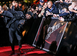 Coach Will.Iam slips on the red carpet before the Blind Auditions begin for the new series of  The Voice on ITV.
