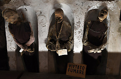 NO WEB FOR FRANCE - The Capuchin Catacombs of Palermo, Sicily, Italy on January 2019. The catacombs contain about 8000 corpses and 1252 mummies. Palermo's Capuchin monastery outgrew its original cemetery in the 16th century and monks began to excavate crypts below it. In 1599 they mummified one of their number, recently dead brother Silvestro of Gubbio, and placed him into the catacombs. The cemetery was first reserved for ecclesiastical workers, then accepted deceased from all walks of life, and experienced its greatest popularity during the 19th century. An inscription hanging from the neck or pinned to the chest, indicates the name, birth and death dates of the deceased.The cemetary was officially closed by civil order in 1880. But the last burials are from the 1920s. The cemetary has now become a kind of museum, filled with the forgotten dead, who are watched over by a group of Capuchin monks. Sicily will reveal over time a real research laboratory on mummification. It is spreading throughout the island and there is not an important village in sight that does not display the bodies of their priests, monks or citizens in the crypt of their church. Photo by Eric Vandeville/ABACAPRESS.COM