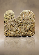 Hittite relief sculpted orthostat stone panel of Herald's Wall Limestone, Karkamıs, (Kargamıs), Carchemish (Karkemish), 900-700 B.C. Anatolian Civilisations Museum, Ankara, Turkey.<br /> <br /> Two sphinxes standing on their hind legs on both sides attack to the winged horse standing on its hind legs in the middle.  <br /> <br /> Against a brown art background. .<br /> <br /> If you prefer to buy from our ALAMY STOCK LIBRARY page at https://www.alamy.com/portfolio/paul-williams-funkystock/hittite-art-antiquities.html  - Type  Karkamıs in LOWER SEARCH WITHIN GALLERY box. Refine search by adding background colour, place, museum etc.<br /> <br /> Visit our HITTITE PHOTO COLLECTIONS for more photos to download or buy as wall art prints https://funkystock.photoshelter.com/gallery-collection/The-Hittites-Art-Artefacts-Antiquities-Historic-Sites-Pictures-Images-of/C0000NUBSMhSc3Oo