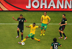 Mexico's Carlos Salcido vs South Africa's Kagisho Dikgacoi during the Group A first round 2010 FIFA World Cup South Africa match between South Africa and Mexico at Soccer City Stadium on June 11, 2010 in Johannesburg, South Africa.  (Photo by Vid Ponikvar / Sportida)
