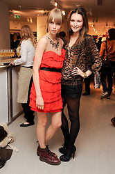 Left to right, EDIE CAMPBELL and AMBER ATHERTON at the H&M Home Launch held at 174-176 Oxford Street, London W1 on 2nd November 2010.