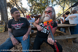 Harry Fryed of the Fryed Brothers Band plays for Ed Rieken in between sets at the Broken Spoke Saloon. Daytona Bike Week 75th Anniversary event. FL, USA. Wednesday March 9, 2016.  Photography ©2016 Michael Lichter.
