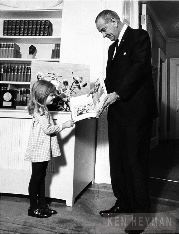 President Lyndon Johnson with Ken Heyman's daughter, Jennifer at the White House.