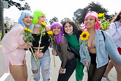Flower children pose for a group photo at the 107th running of the Bay to Breakers, Sunday, May 20, 2018, in San Francisco. (Photo by D. Ross Cameron)